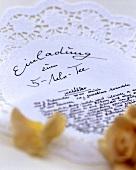 Invitation to 5 o'clock tea on lace doily