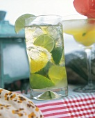 Caribbean drink with pieces of lime (Caipirinha)