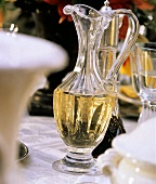 A Glass Pitcher with Olive Oil