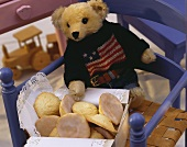 Amerikaner (round iced biscuits) and teddy bear