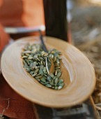 A plate with pumpkin seeds
