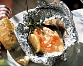 Fish Fillet Wrapped in Tin Foil; Tomatoes
