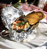 Fish Fillet in Tin Foil; Tomatoes and a Baguette