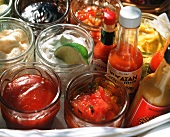 Various sauces and dips for grilled food