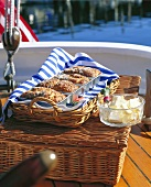 Vegetable breads in baking tins and butter dish on boat