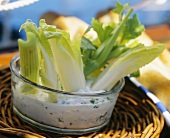 Celery Sticks in a Bowl of Vegetable Dip