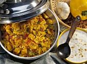 Chicken pilaff: tomatoes, peppers, raisins, saffron & pine nuts