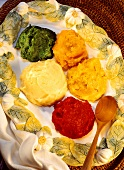 Mashed potato coloured with saffron, carrots, spinach, beetroot