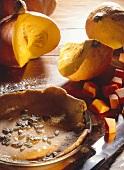Pumpkin Pie with Pumpkin Seeds and Fresh Pumpkins
