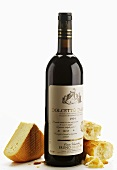 A piece of washed-rind cheese with red wine Dolcetto d'Alba
