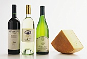 A piece of hard cheese & suitable red & white wine in bottles