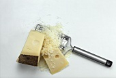Emmental cheese in two pieces & grated with cheese grater