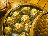 Pasta parcels with shrimp filling in bamboo steamer