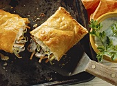 Brook trout with brown mushrooms & vegetables in puff pastry