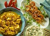 Shrimp kebabs; halibut in curried coconut sauce