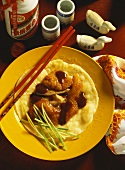 Peking duck on flatbread with spring onions & soya paste
