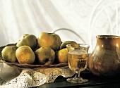 Glass of Sparkling Cider with Basket of Apples