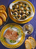 Snails with herb butter and boiled ham in aspic