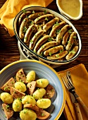 Potato gratin with sausages & sliced sausages with potatoes