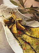 Fried aubergine slices with thyme & strips of chili