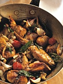 Rabbit saute (rabbit pieces with artichokes & vegetables)