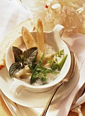 White asparagus cream soup with mangetouts, peas & mint
