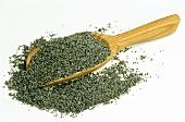 Opium poppy on wooden scoop