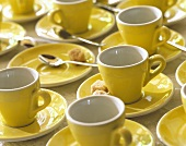 Yellow espresso cups, coffee spoon & brown sugar lumps