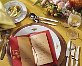 Place setting with menu for five-course meal