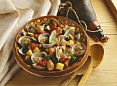 Portuguese eel stew with clams, olives and tomatoes