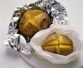 Potatoes in foil and greaseproof paper