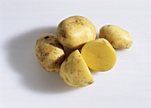 Several potatoes, on cut into two halves