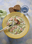 Kohlrabi soup with Vienna sausages & spring onions