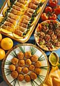 Ham rolls with orange, stuffed mushrooms, chicken cakes