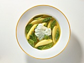 Potato soup with mangetouts and  sour cream with basil