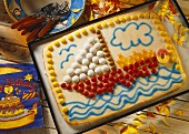 Cake with sailing boat picture in sweets and gummi bears