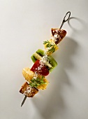 Exotic kebab with turkey breast, fruit & coconut flakes