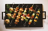 Various kebabs on barbecue rack