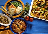 Three chicken dishes (with tarragon, lemons, vegetables)
