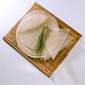 Round & triangular rice paper, with a bunch of chives