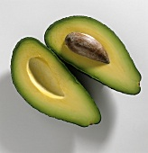 Two avocado halves with and without stone