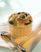 Cauliflower and broccoli souffle in glass dish