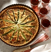 Wagon wheel quiche with mushrooms and spring onions