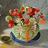 Raw vegetable kebabs on savoy cabbage