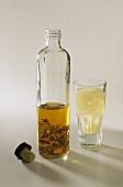 A bottle and glass of aniseed schnapps