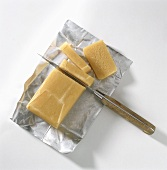 Block of Parmesan Cheese Being Cut