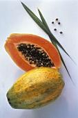 Two Papaya; One Cut in Half