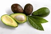 Whole avocados and two avocado halves