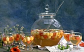 Melon punch in large glass bowl & several glasses