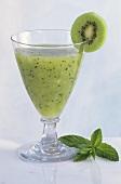 Kiwi drink with kiwi slice and mint leaves
